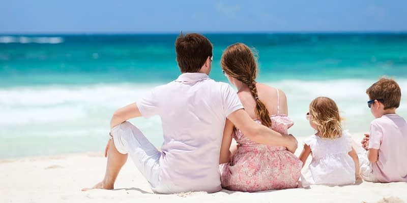 Family on the beach in the Caribbean